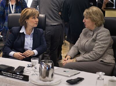 British Columbia Premier Christy Clark, left, chats with Newfoundland and Labrador Premier Kathy Dunderdale as the premiers gather for an economic summit in Halifax on Friday, November 23, 2012. THE CANADIAN PRESS/Andrew Vaughan