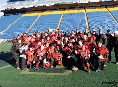 The St. Vital Mustangs Bantam Black team celebrates its Manitoba Minor Football Association championship.