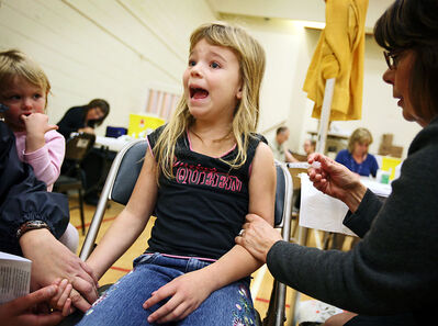 Emma Fraser reacts as she receives her flu shot last Saturday at the Brandon Regional Health Centre.