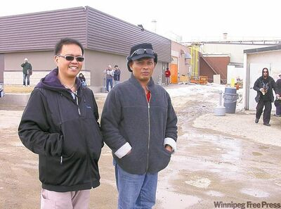 Olivan Afuang (left) and Efren Macatangay immigrated to Neepawa from the Philippines. Macatangay works in the HyLife Foods hog plant behind them, while Afuang is a registered nurse.   Below, the AspenLea apartment complex is scheduled to open this summer, offering some relief to Neepawa's housing shortage.