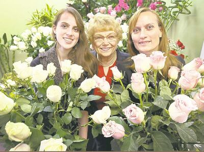 Three generations of flower sellers at their McDiarmid Flowers shop at 382 Academy Road (below, from left) Brooke Sidney, owner Marion Shewchuk and her daughter, Gayle Sidney, help couples show their love with bouquets.