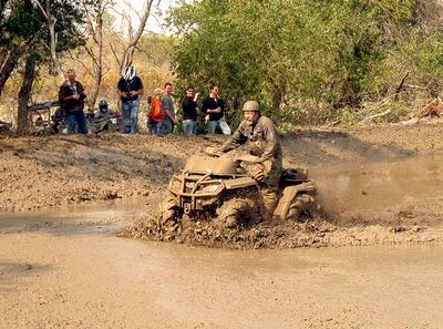 Dale Loewen, the owner of Sandale Fabrication in Grand Pointe, spent the better part of the day playing in the mud aboard his Can-Am ATV.