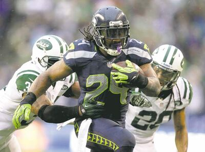 stephen brashear / the associated pressSeattle RB Marshawn Lynch speeds past New York Jets defenders Sunday afternoon in Seattle. Lynch ran for 85 yards on 13 carries in the second half.