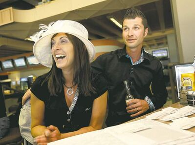 Sherry and Ryan Cote watch the 139th Kentucky Derby at Assiniboia Downs.