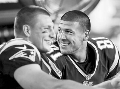 Elise Amendola / the associated press archivesNew England Patriots tight ends Aaron Hernandez, right, and Rob Gronkowski.