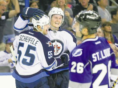 Jets centre Mark Scheifele (left) is starting to show his worth, while teammate Jacob Trouba has been a big asset from Day 1.