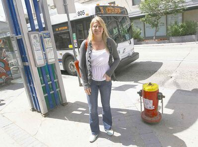 Samantha Samson at her favourite place in the city, the northbound bus stop at Graham Avenue and Vaughan Street.