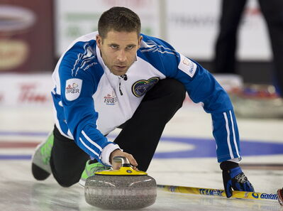 British Columbia skip John Morris delivers a rock against Alberta in playoff action at the Tim Hortons Brier in Kamloops, B.C. on Friday, March 7.