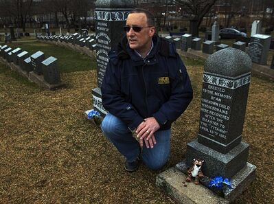 Bill Arbuckle, a senior parks official and former graveyard worker for the Halifax Regional Municipality, visits the grave of the unknown child from the Titanic disaster at the Fairview Lawn Cemetery in Halifax on Thursday April 5, 2012. Scientists, using an advanced form of DNA decoding, determined that the toddler was in fact 19-month-old Sidney Leslie Goodwin, a third-class English passenger whose family perished in the sinking. THE CANADIAN PRESS/Andrew Vaughan