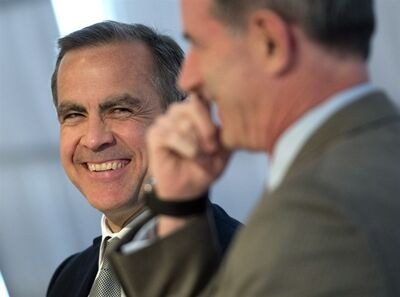 Bank of Canada governor Mark Carney shares a laugh as he participates in a panel discussion about Rebuilding Trust in Global Banking, organized by Cardus' The Convivium Project. The panel was held at the Toronto Board of Trade on Friday May 3, 2013. THE CANADIAN PRESS/Frank Gunn