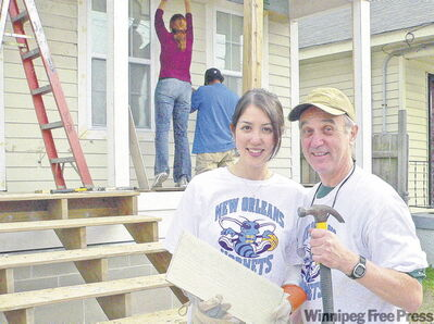 Father-daughter team Lisa and Lorne Mallin volunteer at a Habitat for Humanity house being built in New Orleans' flood-ravaged Ninth Ward.
