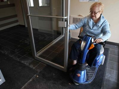 Manitoban Lois Strong, who has muscular dystrophy and arthritis, hopes the province follows Vancouver's lead and requires new buildings to have door levers, not doorknobs, which she has trouble using.