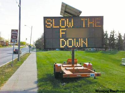 A roadside sign on Roblin Boulevard at Berkley Street, placed by Manitoba Public Insurance, had its sign altered by a hacker on Sunday. The Free Press chose to blur the profane portion of the message.