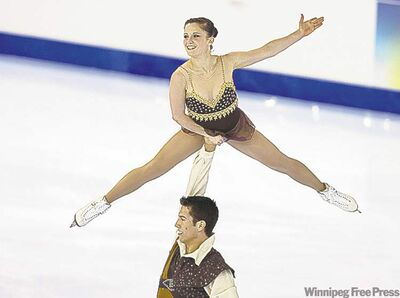 andrew vaughan / the canadian pressPaige Lawrence and Rudi Swiegers skate to bronze in the senior pairs free competition.