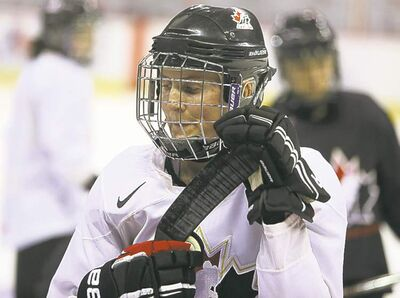 Hayley Wickenheiser takes a break at practice Sunday. Canada plays Russia today.