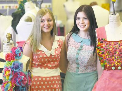 Kaylee Driver, left, proudly displays her pink polka dot dress, and Rayanne Boittiaux with her Green and pink dress.