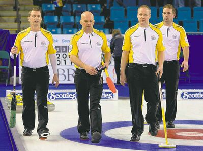 Manitoba's Jeff Stoughton (from left), Jon Mead, Mark Nichols and Reid Carruthers leave the ice after eking one out over the Northwest Territories Sunday.