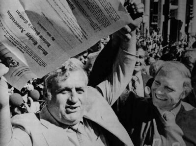 Ben Hatskin (left) holds up Bobby Hull's historic million-dollar contract at Portage Avenue and Main Street in this 1972 photo.