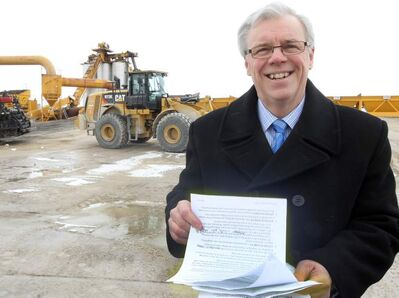 Premier Greg Selinger used an asphalt plant as a background today to pitch his infrastructure-spending plan from the latest provincial budget.