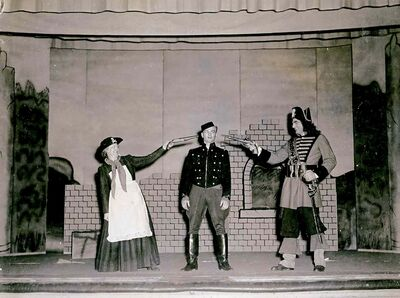 M. Burrows (from left), Jon Vicars and Harold Vance in the Flin Flon Glee Club's 1947 performance of Pirates of Penzance.