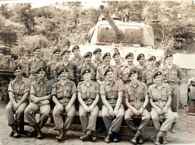 Stanley Jaworski, fifth from the right in back, and his troop in Korea, which consisted of 20 men divided between four tanks. The photo hangs in his home.