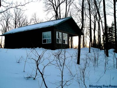 The rustic riverside cabins at Getaways Romantic Retreat southeast of Beausejour are warm and charming.