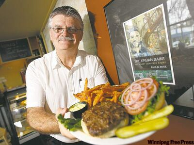 Manager Tim Thiessen with the Ellice Cafe's burger and yam fries.
