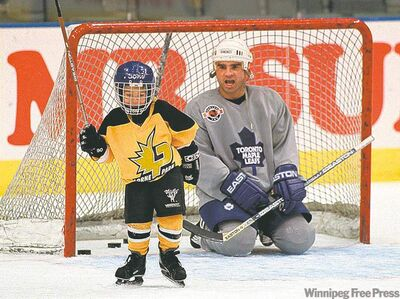 Tie Domi�s son, Max, the sniper in the family, is lighting up the OHL this season as a rookie with the London Knights. Max the younger (left) gets some puckhandling advice from papa back in 1999.