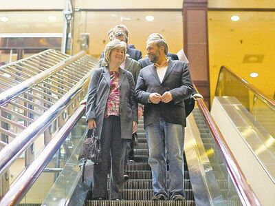 Chris Young / The Canadian PressThomas Mulcair arrives at an NDP caucus meeting with chief of staff Anne McGrath in Toronto on Sunday.