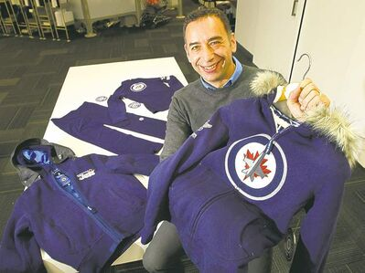 Tony Lavilla,  brand director  for Mondetta,  shows off some  of the Winnipeg company's Jets clothing.