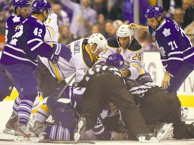 The donnybrook got so bad, even the goalies -- Leafs' Jonathan Bernier and Sabres'  Ryan Miller -- got into it. David Clarkson (right) earned a 10-game suspension for leaving the bench and won' t be eligible to play until Oct. 25.