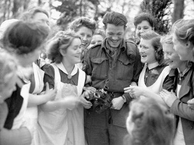 Rifleman R.M. Douglas, of the Royal Winnipeg Rifles, celebrates liberation with a group of Dutch women on April 10, 1945. Canadian soldiers were affectionately dubbed the 'loverboys' in Holland.