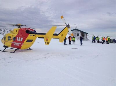 Emergency services crew are seen in this undated recent photo in Kosciuszko National Park, about 350 kilometres southwest of Sydney. THE CANADIAN PRESS/HO - Westpac Life Saver Rescue Helicopters - Facebook