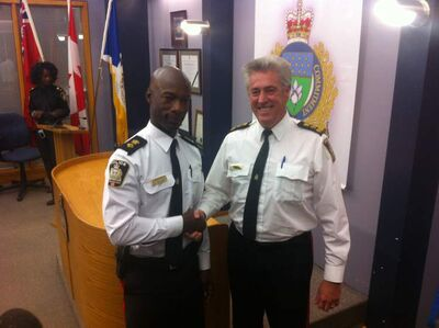 New Winnipeg Police Chief Devon Clunis (left) with outgoing chief Keith McCaskill.