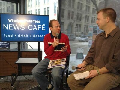 Sean Grassie (left) chats with Geoff Kirbyson at the Free Press News Café.