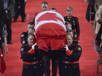 Pallbearers carry the casket of Const. Jennifer Kovach at her funeral in Guelph, Ont., on Thursday, March 21, 2013. Kovach, 26, died a week ago today when her cruiser crossed the centre line and collided with a Guelph Transit bus. THE CANADIAN PRESS/Nathan Denette