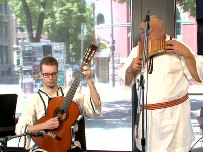 Members of the Romanian Pavilion perform today at the News Café.