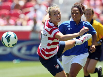 U.S. midfielder Amy Rodriguez, (left) and Canada's Desiree Scott, will meet again on the pitch — this time at Investors Group Field next week.