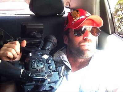 This undated family photo released Thursday, April 25, 2013, shows Timothy Tracy inside of a vehicle in Venezuela. The 35-year-old filmmaker from California was arrested Wednesday, by Venezuelan authorities who are accusing him of fomenting post election violence on behalf of the U.S. government. Friends and family told The Associated Press said that he had been in Venezuela since last year making a documentary about the confrontation between the opposition and a socialist government that is struggling to maintain its once-high popularity after the death of Venezuela's late President Hugo Chavez. (AP Photo/Family courtesy photo)