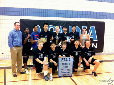 The Acadia Axemen, winners of the Pembina Trails Athletic Association volleyball championship, with coaches Andrew Mathewson (l.) and Alex Graham.