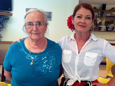 Carmen Infante (left) teaches Spanish folkloric dance to many girls and women, including Shelagh Williamson (right).