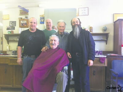If you want your hair cut by Larry Goutsos (second from right) at Larry's Barbershop, be prepared to wait in line.