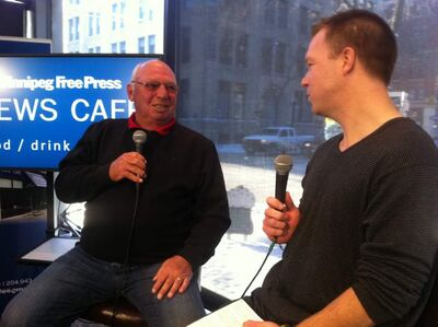 Dennis Hull (left) talks to the Free Press' Geoff Kirbyson at the News Cafe on Tuesday.