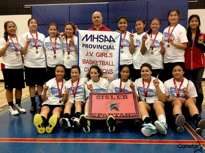 The Sisler Spartans celebrate their provincial junior varsity girls' basketball championship. The team has lost only one game over the last two seasons.