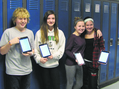 Lincoln Middle School students hold up the Great Kindness Challenge survey on their iPads and showcase all the caring deeds they accomplished. Pictured from left to right is Troy Borthistle, Aimee Patrick, Lilja Fileccia and Katie Bassett.
