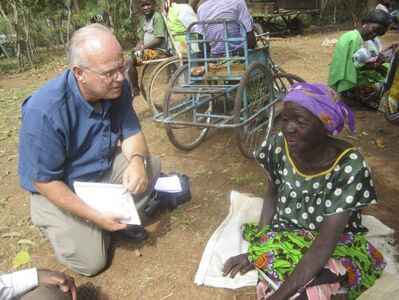 Jim Cornelius interviews Elizabeth Nabaloum in Burkina Faso. Elizabeth is one of the people who received food through a Canadian Foodgrains Bank response to hunger during the food crisis in the Sahel.