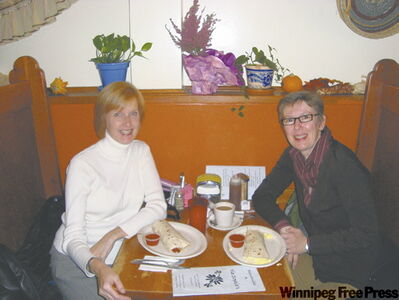 Lindor Reynolds and friend Cate Harrington having breakfast burritos at Tia Sophia's.