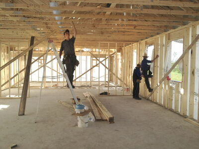 Chad Bauman of the Pine Creek Mennonite Church helps members of the Old Order Mennonite community with construction inside the new school. The teen is one of dozens of Mennonites from across the province and beyond who travelled to the Old Order Mennonite community to help.