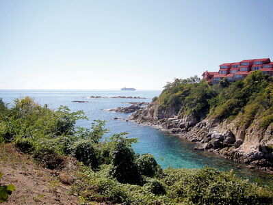 Dramatic Tangolunda Bay, one of nine inlets along the Huatulco tourist region's Pacific coastline.
