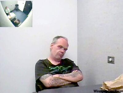 Mark Edward Grant being interviewed by police in 2007.
